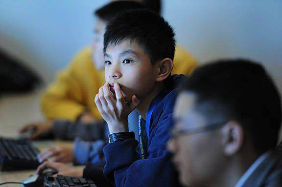 JETS_2001_0229_asian_boy_computer_thoughtful_sm