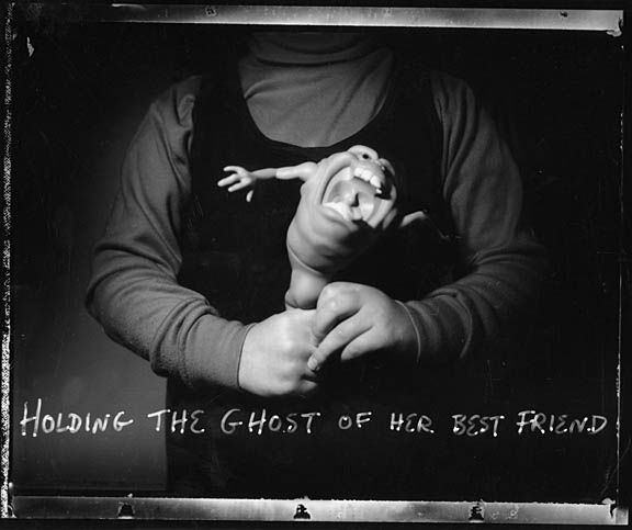Holding_the_ghost_of_her_best_friend_001_sm